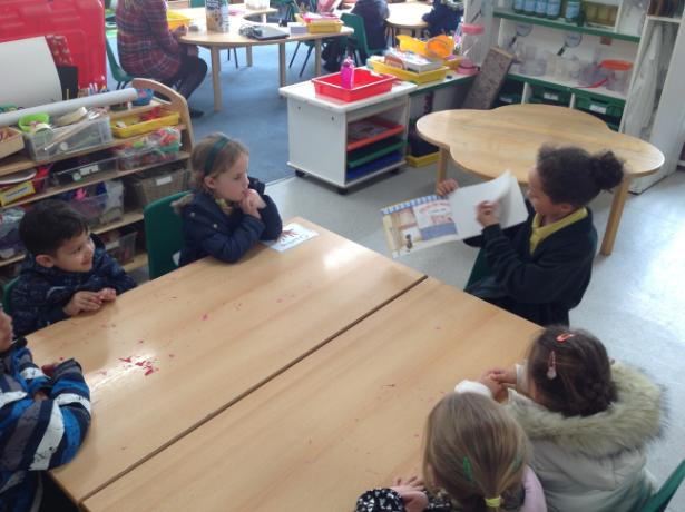 Year 5 reading to Reception